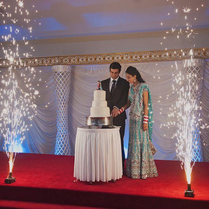 Indian wedding cake cutting.  Brisbane wedding photographer. Swirltography