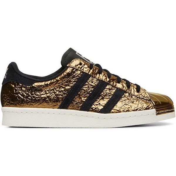 Adidas Originals Black and Gold Superstar Low Top Sneaker ($180) ❤ liked on…