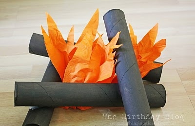 CRAFT: To make a fire, paint some paper towel tubes brown (don't paint evenly, the streaks will help it look like wood) and tape them together. I used orange napkins ( that I cut) because that is what I have but I think orange cellophane would look even better. You can use tissue paper too.