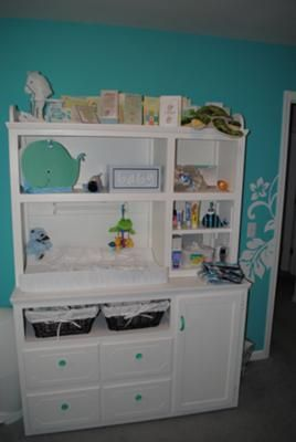 White Painted Nursery Furniture in our Baby's Blue Hawaiian Nursery: We used our love for tropical settings and the ocean in all of our Hawaiian nursery decorating ideas.  The nursery's decor had to be gender neutral since