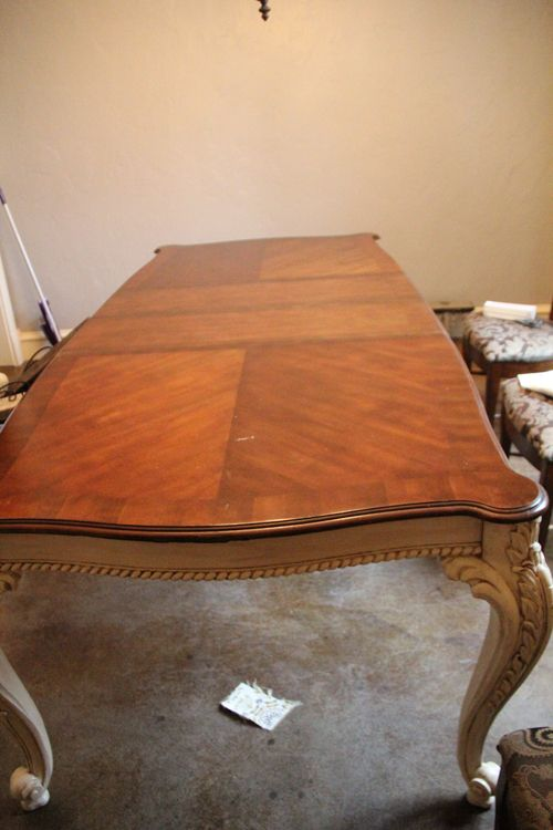 Love this look – it was an old beat up table, and she painted the bottom & stained the top. LOVE!