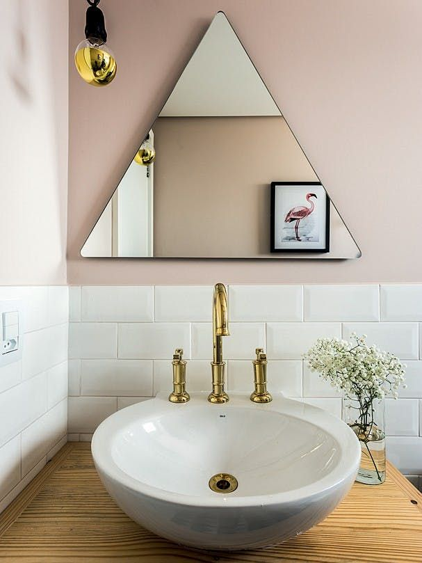 Dusty pink is a color that's been cropping up in a lot of places lately, and it's especially nice in the bathroom. It's a nice way to impart some of that moody color without going too dark. Image from Glamour.