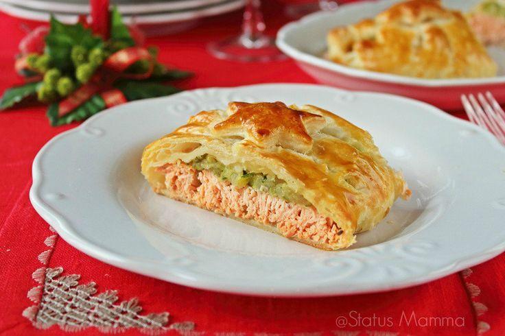 Salmone in crosta: ricetta di un gustoso secondo con zucchine e patate avvolte in pasta sfoglia, cottura al forno.