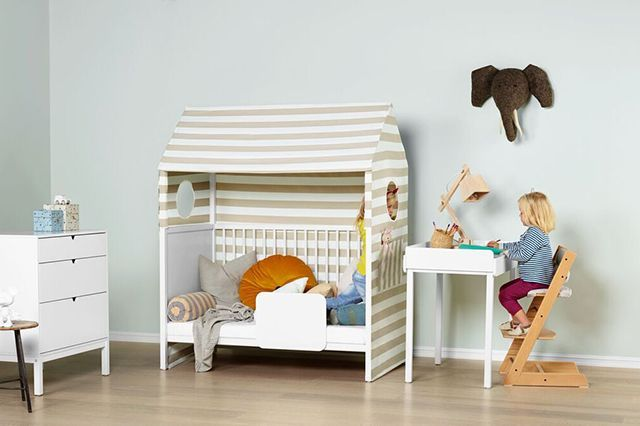 How To Make A Modern Kid's Room YOU'LL Want To Live In featuring Stokke Home #refinery29 http://www.refinery29.com/modern-kids-room#slide-2 A crib-slash-changing-area-slash-playhouse — this Stokke crib really does it all. Made to grow with your baby as she gets older, it turns from a bassinet to a crib, then to a bed, and then a playhouse. Stokke Home Crib, $700, available at Stokke....
