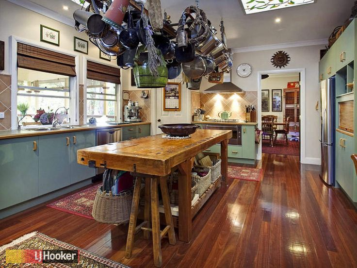Great kitchen - beautiful old island bench and pot hanger. No crisp minimalism here!