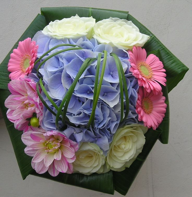 Hand-tied posy using Hydrangea, Roses, Dahlia's, Germini's. Aspidistra leaves and steelgrass. Created by Floresta.co.uk