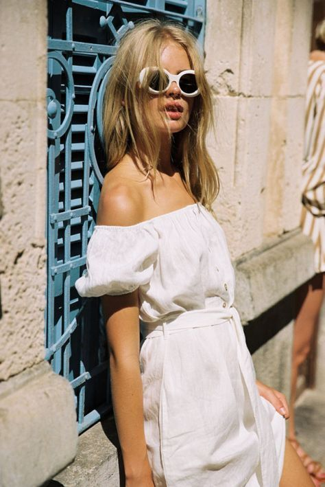White cat eye sunglasses and off-the-shoulder dress