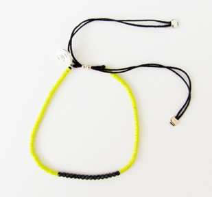 Yellow and black crystal beaded bracelet: Yellow glass bead and black Sarovski crystal bracelet on 100% silk thread.  size adjustable.  $45