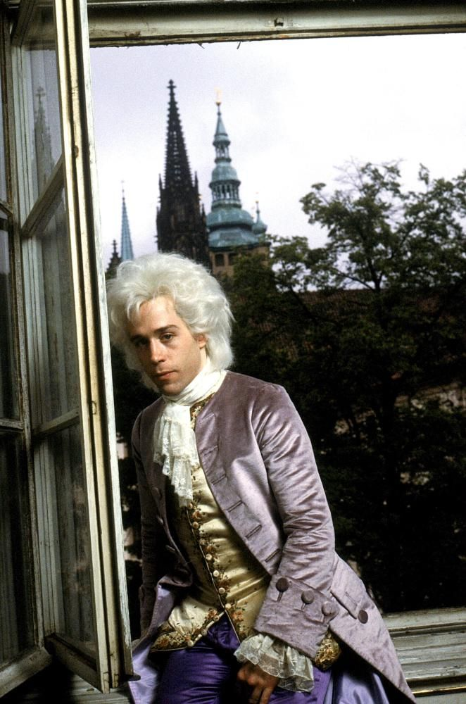 Tom Hulce as Mozart looking depressed after his father comes to visit at his new apartment. His father has arrived too late to talk him out of marrying Constanze Weber. Outside the window, Prague fills in for 16th century Vienna.