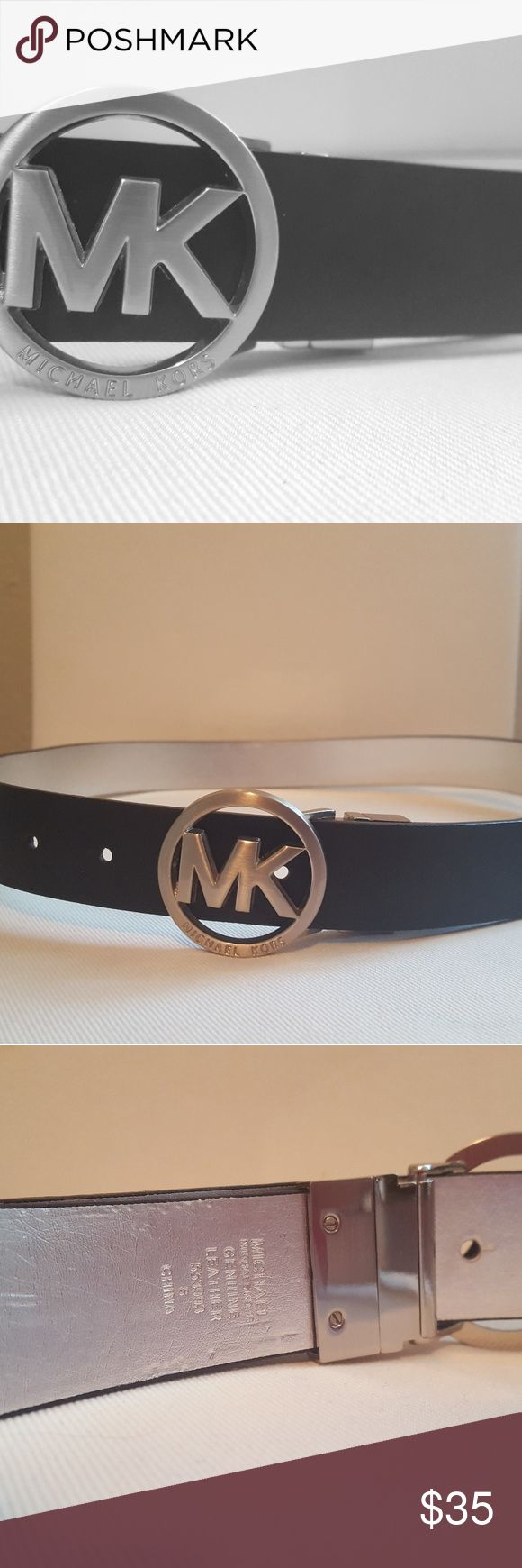 Michael Kors Logo Belt (Reversible) Classic black leather belt with Signature MK Logo buckle. Reversible hinge feature reveals a shiny silver alternate side. Light wear, most visible on silver side in some areas (see photos). Style has no loophole but usually stays nicely tucked into belt loop when worn. Overall very comfortable and in good condition! Michael Kors Accessories Belts