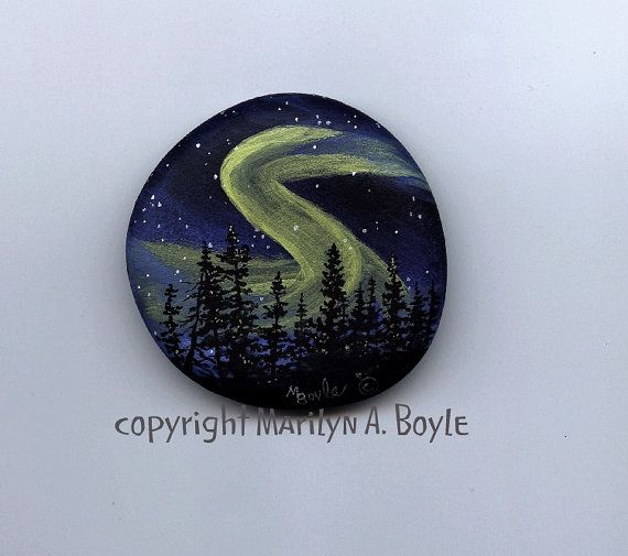HAND PAINTED STONE; original art, scene, night, northern lights, aurora borealis, stars, fir trees, nature, wilderness,