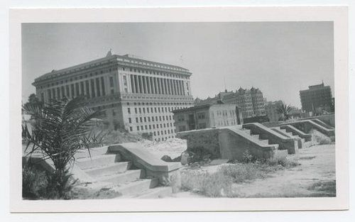 The ghosts of Fort Moore Hill, 1949 | Layne Purchase. Deserted steps, where houses have been moved to make way for the excavation- Fort Moore Hill. Hall of Justice in the background. June 19, 1949. Neg available D-763. L. Mildred Harris 334 N. Heliotrope Drive Los Angeles, Calif., Fort Moore Hill  Judging from the angle these are the stairs and porches of the houses (and one rooming house) on the east side of the street in the 400 block of N. Hill Street.