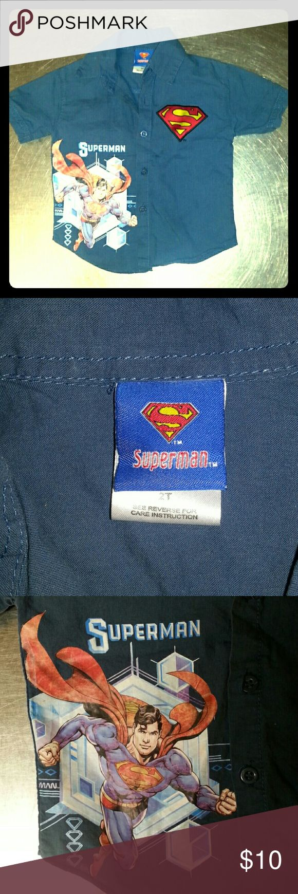 Superman boys button-up shirt This is an adorable blue button up superman shirt for small boys. It's size 2T. Lightly worn, no stains, all buttons in tact. Superman Tops Button Down Shirts