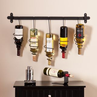 @Overstock - Upton Home Winston Wall Mount Wine Rack - This unique Upton Home wall mount wine rack features five coil holders to store bottles upside down showing off your favorite labels. The natural, wrought iron finish gives this wall mount a charmingly industrial touch.   http://www.overstock.com/Home-Garden/Upton-Home-Winston-Wall-Mount-Wine-Rack/9237698/product.html?CID=214117 $44.99