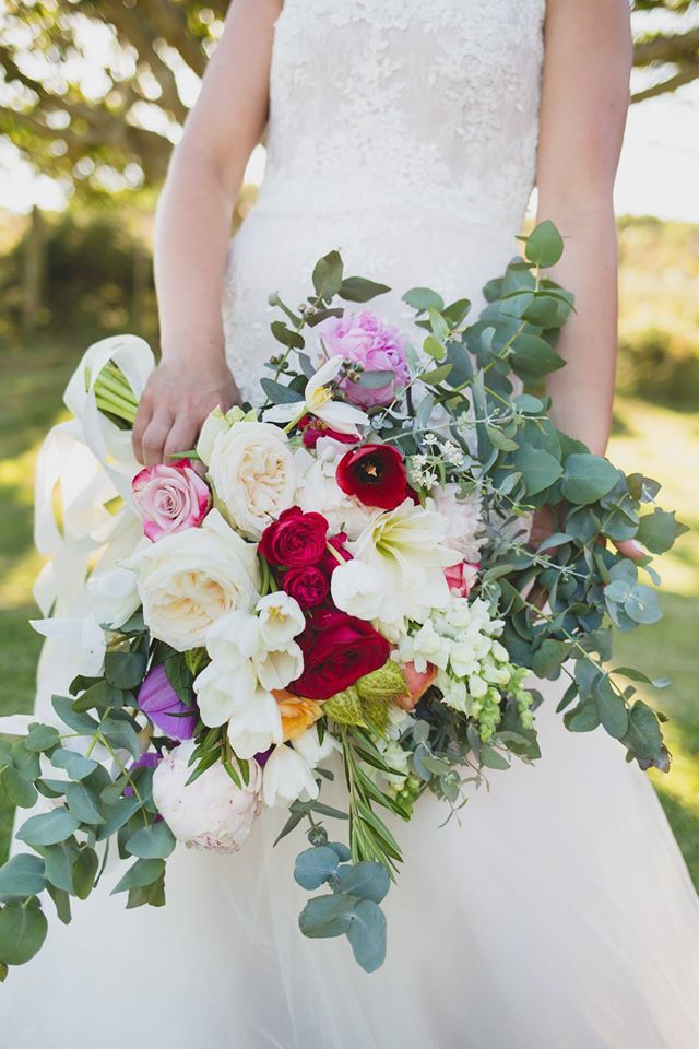 This beautiful bouquets includes, O'Hara garden roses, white and red tulips, Peonies, eucalyptus. Photo by Shaula Greyvenstein. Bouquets by Must Love Flowers - Jeffreys bay