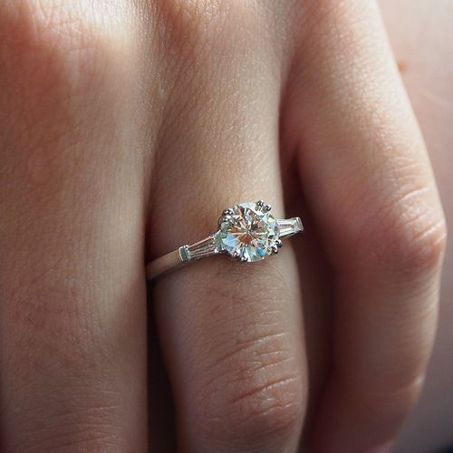 This ring is delicate and absolutely gorgeous! Round Brilliant Moissanite with Tapered Baguette Engagement Ring Model No: eng880