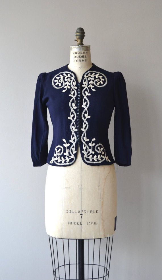 Vintage 1930s navy blue rayon crepe blouse with white embroidery, very fitted shape, 3/4 sleeves and faceted buttons.  ✂-----Measurements  fits like: xs/small shoulder: 14 bust: 32-34 waist:up to 28 length: 18 brand/maker: n/a condition: excellent  ✩ more vintage coats ✩ http://www.etsy.com/shop/DearGolden?section_id=5800175  ✩ visit the shop ✩ http://www.DearGolden.etsy.com  _____________________ ✩ www.deargolden.com ✩ twitter: deargolden