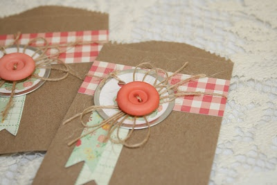 Tiny Kraft bags decorated with October Afternoon papers, twine, buttons, and metal rimmed tags.