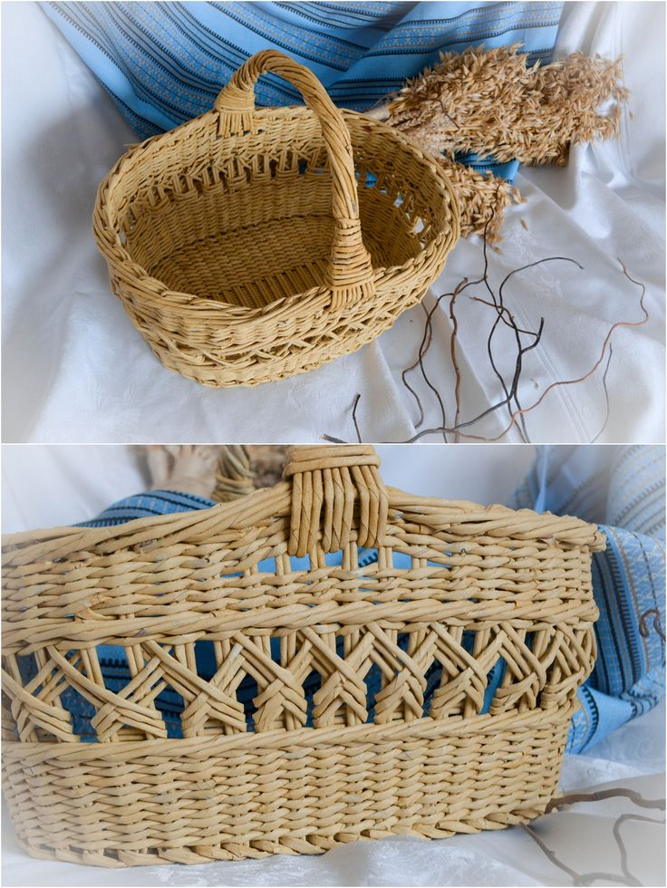 oval round reed basket with overhead handle and open fishbone side decoration