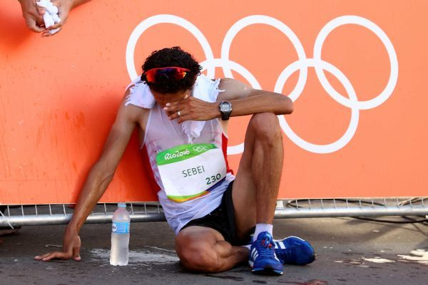 Hassanine Sebei of Tunisia reacts after the Men's 20km Race Walk on Day 7 of the Rio 2016 Olympic Games at Pontal on August 12, 2016 in Rio de Janeiro, Brazil.