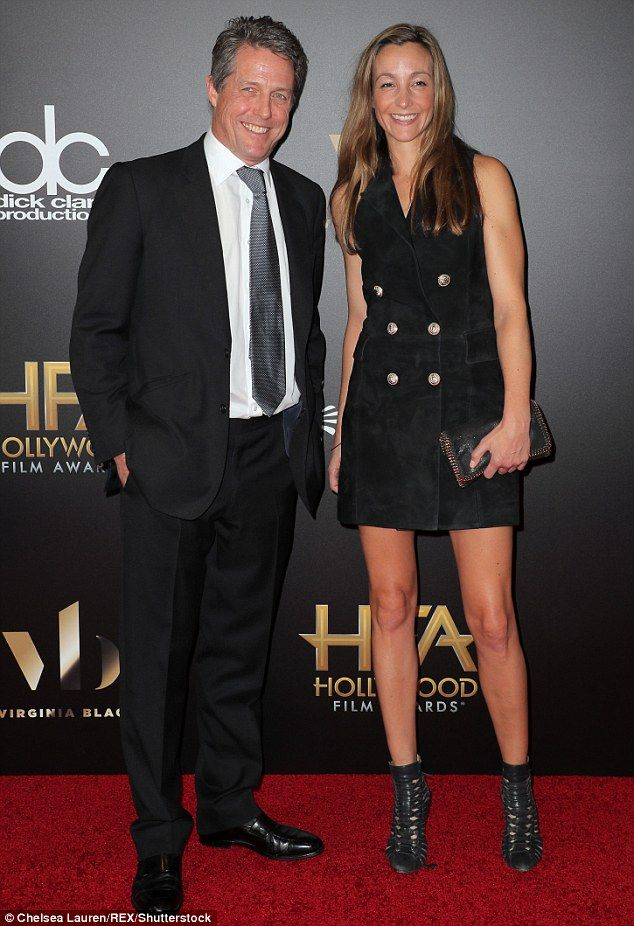 Going public: Hugh Grant, 55, and his girlfriend Anna Eberstein, 37, made a rare red carpet appearance together on Sunday at the 20th Annual Hollywood Film Awards in LA
