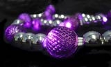 $16.25 These lit LED purple bead garland strings use very little energy and can last a lifetime.  There are no bulbs to break or burn out, which makes them wonderfully low-maintenance.  20 LED purple Christmas lights (purple covers) are on a white cord covered with mirror silver beads between each purple light.  The spheres have a great purple color and are textured to provide a slight pattern to the light.