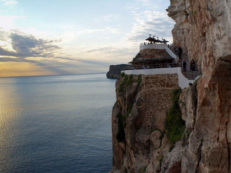 Cova d'en Xoroi, located in Alaior, Menorca, is perched about 100 feet above the Mediterranean Sea. It offers stunning views of the water during the day and spinning DJs that help you party away at night.