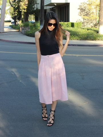 Tailored and subtly pleated, pink culottes are as appropriate for the office as they are for a day of shopping on the promenade. Tuck a white blouse into them or wear a turtleneck and add a jacket and