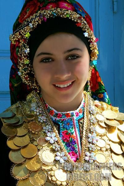 Greece | Young Karpathos woman in national costume | Photographer unknown