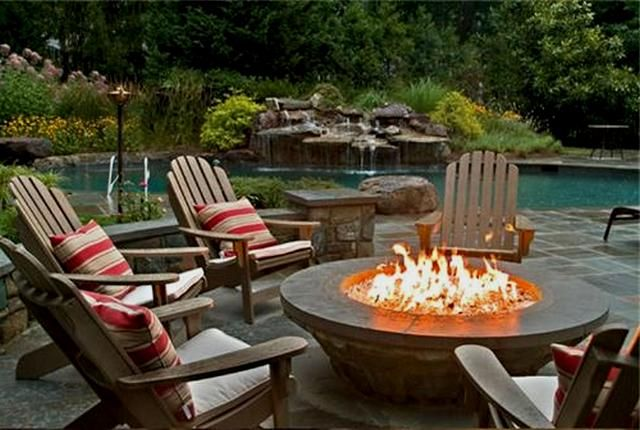 for the patio by the water:  Gas Fire Pit - works with a gas tank like the ones used with your gas grill.  Run the line under the patio and viola! fire pit!