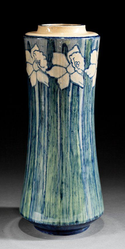 """Newcomb College Art Pottery High Glaze Vase, 1902, decorated by Harriet Coulter Joor with daffodils, green and blue underglaze, based marked with Newcomb cipher, decorator's mark, Joseph Meyer's potter's mark, reg. no. N62 and """"Q"""" for buff clay body, h. 12 in. Provenance: Jean Bragg Gallery, New Orleans, 2002. Ill.: Bragg, Jean and Dr. Susan Saward. The Newcomb Style, p. 88, no. 117"""