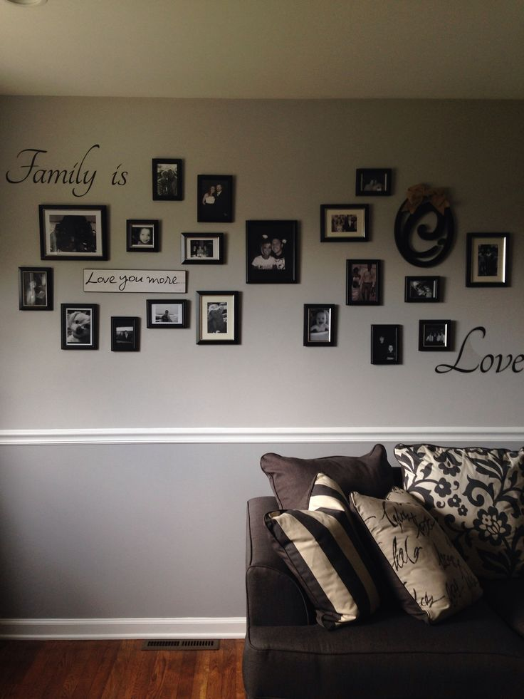Photo collage on two tone gray wall with chair rail. More