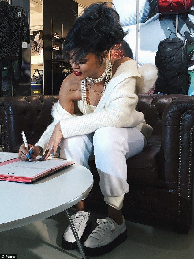 She makes it official! Rihanna signs 'on the dotted line,' as she said on her Instagram when she posted this photo taken inside the Puma offices in Germany