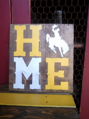"""Handmade wooden sign. 11.25"""" X 12"""". Yellow and white lettering."""