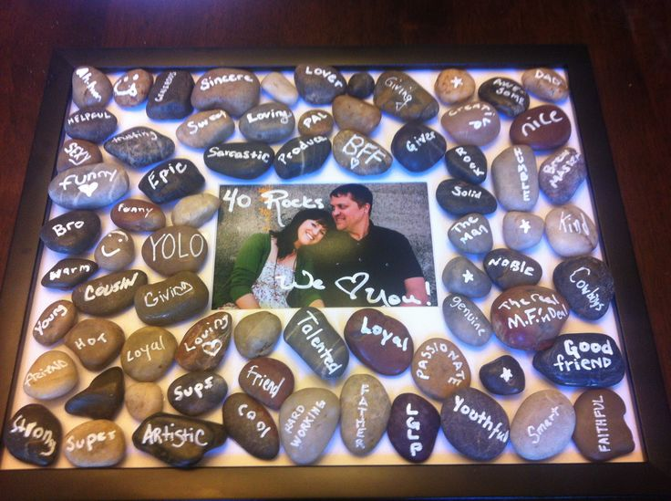 "I looked all over Pinterest for a thoughtful 40th party gift, I couldn't find anything, so i'm sharing what i came up with.. have fiends write a word on a rock that describes the birthday guy/girl ""40 Rocks"". Adhere it to a large canvas w strong adhesive! I used more than 40.."