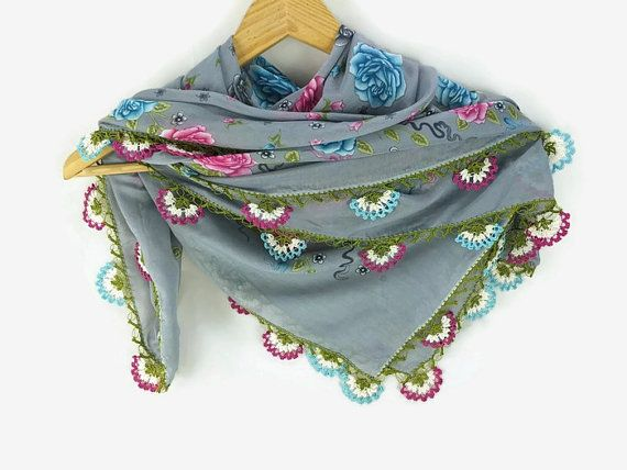 Blue Gray Floral Turkish Oya Scarf with crochet oya flower edges.      This cute scarf is made of lightweight and very soft poly cotton scarf fabric.    It has a soft silky feeling . All edges are hand trimmed and embellished with   hand crochet oya lace flowers for a unique look .    .  Versatile and feminen to wear all year around . Wear as a head scarf/bandana in  hot summer days to save your head from direct sunlight, or carry it on your neck  as a chic  neck scarf.         It is a…