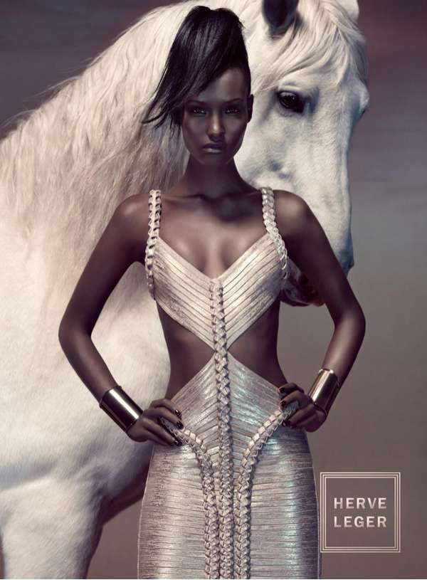 Clever shot from the point of view that if you could see any more of the horse it may well upstage the model. From this angle the dress still looks really good. loving her horsy styled hair!
