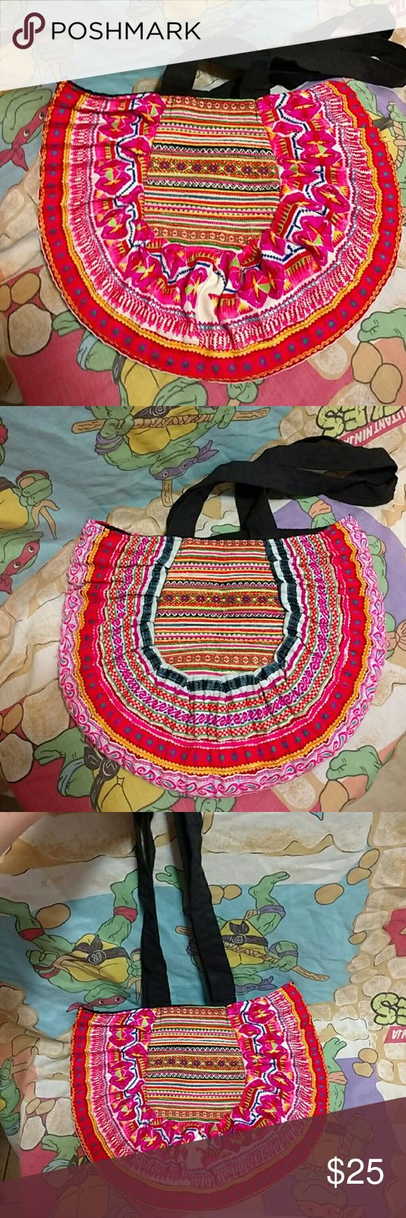 Tribal Aztec Purse 13.5 x 10.5. Strap length is 14. Beautiful embroidered purse. You can feel all the different textures. Each side is slightly different. Roomy for all your essentials. There are a few loose threads on each side, please see last pics. Doesn't effect the wear or design. No tags. Bags Shoulder Bags