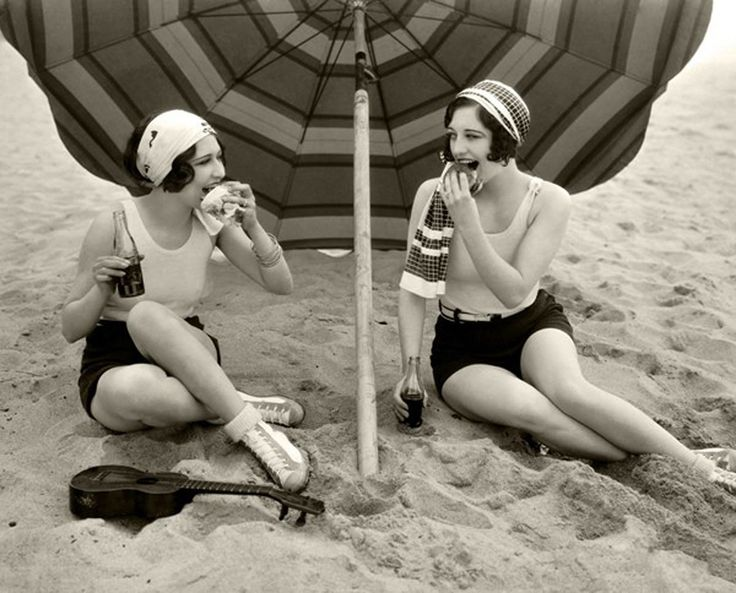 Dorothy Sebastian and Joan Crawford late 1920′s having a picnic on the beach at Santa Monica, California