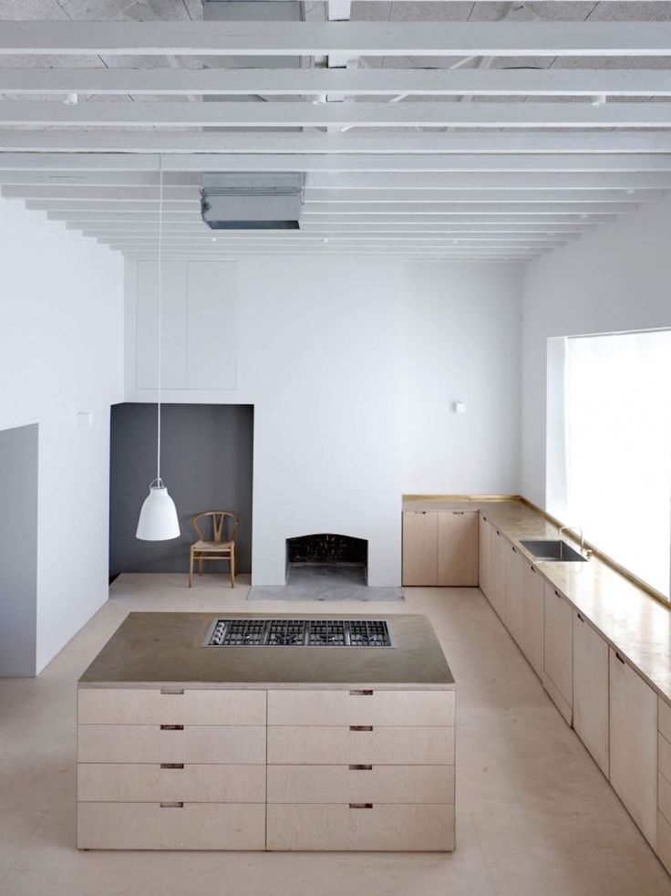 The architects behind this kitchen project used birch plywood, concrete, wood wool and brass to create this inviting home. McLaren.Excell - April and mayApril and may