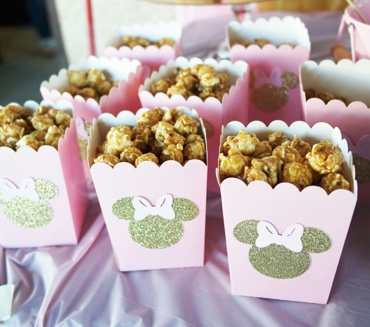 Pink and gold minnie mouse birthday party treat candy buffet table sign popcorn boxes glitter