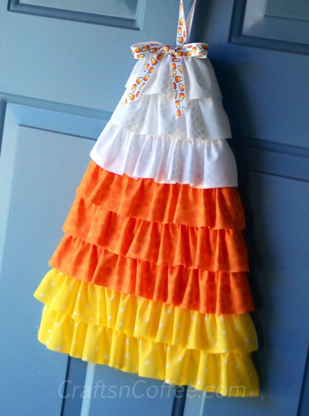Candy Corn Crafts week: DIY Ruffled Candy Corn Door Décor - I realize this is a door decoration, but a cute idea for a halloween dress.