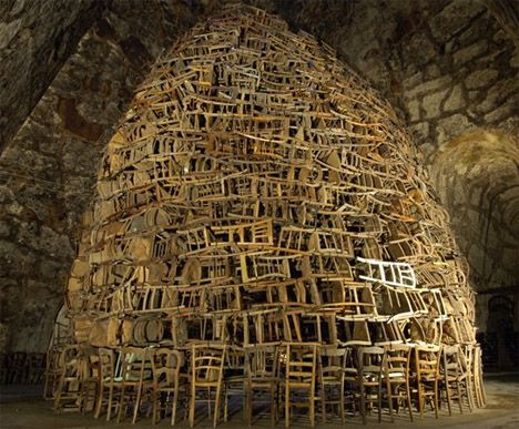 Art installation of discarded chairs.