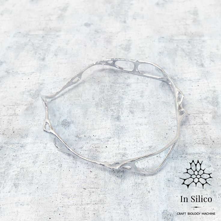 'Phenotype' bracelet. Bone structure inspiration, 3d printing, nickel steel. More info on our site: insilico.pl #minimal #3dprint #jewelry #generativedesign #design #bracelet