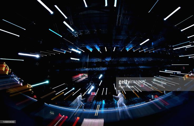 James Davis of Great Britain and Marcel Marcilloux of France compete during the Men's Foil Team Fencing Classification 5-8 on Day 9 of the London 2012 Olympic Games at ExCeL on August 5, 2012 in London, England.