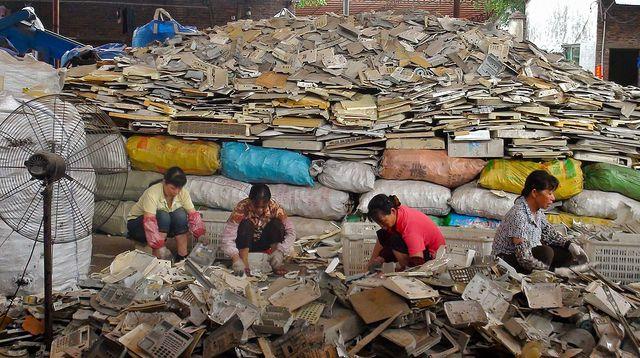 Women sorting Plastics for melting. Outskirts of Guangzhou, China. Smashed cathode ray tubes 'stored' in back of processing shop, Dali, China.