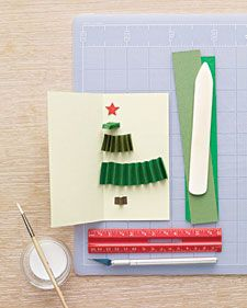 As this card opens, a tree made from pleated paper rectangles pops out, like a small gift. Although it can be glued into any size greeting, it is especially attractive in a tall, slender card that mimics a pine tree's natural dimensions.