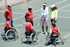 Scores of starry-eyed teens in oversized tennis kits queue neatly, awaiting their turn to play against US champions Serena and Venus Williams in South Africa's famous Soweto township.