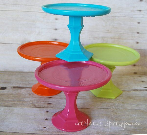 I was looking at these candle plates. I put one together with a candle stick, so I present to you colorful and cute dollar store cake stands.