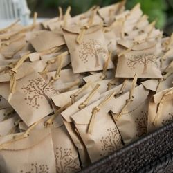 Pretty little brown paper bags filled with mints. Great wedding favor idea!